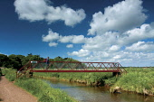 Footbridge over the Biel Water on the John Muir Way, Dunbar, East Lothian. Picture Credit : Keith Fergus / Scottish Viewpoint   Tel: +44 (0) 131 622 7174  E-Mail : info@scottishviewpoint.com  This pho... Public 2012,summer,sunny,Long,Distance,Path,walk,walking,bridge,footpath,walker,people,person