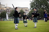 The World Pipe Band Championships on Glasgow Green, east of the city centre of Glasgow. Pictured here young pipers practising for the event. Picture Credit : Iain McLean / Scottish Viewpoint   Tel: +4... Public 2012,summer,tartan,kilt,bagpipes,piping,piper,child,boy