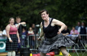 The World Pipe Band Championships on Glasgow Green, east of the city centre of Glasgow. Pictured here a lady competitor in the Highland Games element of the event. Picture Credit : Iain McLean / Scott... Public 2012,summer,tartan,kilt,weight,distance,heavy,woman,female