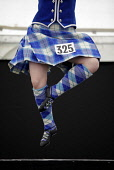 The World Pipe Band Championships on Glasgow Green, east of the city centre of Glasgow. Pictured here Highland Dancing competition in the Highland Games element of the event. Picture Credit : Iain McL... Public 2012,summer,tartan,kilt,competitor,girl,woman,dance,dancer