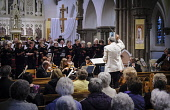 Lanark and Carluke Choral Union give a concert in St Mary's Church in Lanark, South Lanarkshire. Picture Credit : Andrew Wilson / Scottish Viewpoint   Tel: +44 (0) 131 622 7174  E-Mail : info@scottish... Public 2012,interior,event,orchestra,music,singing,religion,religious,audience,conductor,musicians,holy,stained,glass,aisle,pews,people,roman,catholic,RC