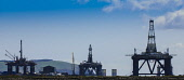 Oil rigs at the fabrication yard at Invergordon on the Cromarty Firth, Highlands of Scotland. Picture Credit : Andrew Wilson / Scottish Viewpoint   Tel: +44 (0) 131 622 7174  E-Mail : info@scottishvie... Public 2012,spring,production,energy,fuel,drill,drilling,north,sea,industry,industrial,platform,petro,chemical,petrochemical,highland,panormic