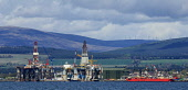 Oil rigs at the fabrication yard at Invergordon on the Cromarty Firth, Highlands of Scotland. Picture Credit : Andrew Wilson / Scottish Viewpoint   Tel: +44 (0) 131 622 7174  E-Mail : info@scottishvie... Public 2012,spring,sunny,production,energy,fuel,drill,drilling,north,sea,industry,industrial,platform,petro,chemical,petrochemical,highland,ship,boat