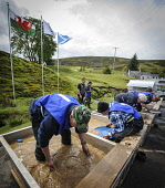 British Gold Panning Championships at Wanlockhead, Dumfries and Galloway. Picture Credit : Andrew Wilson / Scottish Viewpoint   Tel: +44 (0) 131 622 7174  E-Mail : info@scottishviewpoint.com  This pho... Public 2012,summer,event,people,competitors,hills,precious,metal,competition,water,international,flag,flags,saltire,welsh