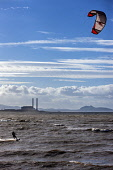 Kite surfing on the Firth of Forth at Longniddry Bents with Cockenzie Power Station visible behind, East Lothian. Picture Credit : Andy Bennetts / Scottish Viewpoint   Tel: +44 (0) 131 622 7174  E-Mai... Public 2012,autumn,sunny,activity,water,waves,sport,kiting,people
