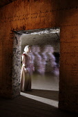 The ghostly figure of a girl walking past a doorway in The Real Mary King's Close, Edinburgh. Pic: Gary Doak / Scottish Viewpoint  Tel: +44 (0) 131 622 7174  E-Mail : info@scottishviewpoint.com  Web:... Public, NMR 2009,interior,attraction,atmospheric,ghost,tour,tours,tourism,tourist,visitor,heritage,history,historical,costume,spooky,eerie,spook,spectre,shadowy,ghostlike,supernatural,unearthly,paranormal