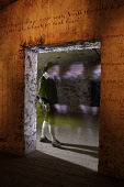 The ghostly figure of a man walking past a doorway in The Real Mary King's Close, Edinburgh. Pic: Gary Doak / Scottish Viewpoint  Tel: +44 (0) 131 622 7174  E-Mail : info@scottishviewpoint.com  Web: w... Public, NMR 2009,interior,attraction,atmospheric,ghost,tour,tours,tourism,tourist,visitor,heritage,history,historical,costume,spooky,eerie,spook,spectre,shadowy,ghostlike,supernatural,unearthly,paranormal