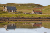 The tiny school on the island of Sanday, now closed due to no families living on the island, Small Isles, Inner Hebrides. Picture Credit : Graham Uney / Scottish Viewpoint   Tel: +44 (0) 131 622 7174... Public 2012,summer,sunny,island,water,reflection,croft,education