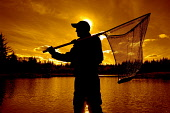 An angler with his catch at sunset. Picture Credit: Scott Whitelaw / Scottish Viewpoint Tel: +44 (0) 131 622 7174   E-Mail : info@scottishviewpoint.com Web: www.scottishviewpoint.com This photograph c... Public, MR 2012,autumn,atmospheric,silhouette,fish,fishing,angling,fisherman,water,activity