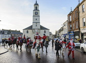 The annual Santa Parade along the High Street in Lanark, South Lanarkshire. Picture by Andrew Wilson Picture Credit : Andrew Wilson / Scottish Viewpoint   Tel: +44 (0) 131 622 7174  E-Mail : info@scot... Public, NMR 2012,winter,event,christmas,xmas,horses,ride,riding,spectacle,costume,costumes