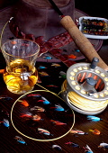 A detail of fishing flies  and a glass of whisky. Picture Credit: Scott Whitelaw / Scottish Viewpoint Tel: +44 (0) 131 622 7174   E-Mail : info@scottishviewpoint.com Web: www.scottishviewpoint.com Thi... Public 2012,interior,fly,fish,angling,activity,line,rodd,reel,drink,hat