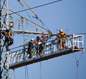 Workers on a pylon near Beauly, Highlands of Scotland. Picture Credit : Laurence Leech / Scottish Viewpoint   Tel: +44 (0) 131 622 7174  E-Mail : info@scottishviewpoint.com  This photograph cannot be... Public 2012,autumn,sunny,highland,power,line,lines,electicity,utility,utilities,people