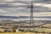 Working on a pylon near Beauly, Highlands of Scotland. Picture Credit : Laurence Leech / Scottish Viewpoint   Tel: +44 (0) 131 622 7174  E-Mail : info@scottishviewpoint.com  This photograph cannot be... Public 2012,autumn,sunny,highland,power,line,lines,pylons,electicity,utility,utilities,people