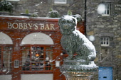 The statue of Greyfriars Bobby commemorating the Skye Terrier that kept watch over his master's grave at the nearby churchyard for 14 years from 1848, in the city centre of Edinburgh.Picture Credit :... Public 2005,winter,weather,snow,capital,city,attraction,visitor,tourist,old,town,commemorate