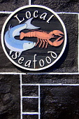 Local seafood sign on the side of the Plockton Hotel, Plockton, Highlands of Scotland. Picture Credit: Scott Whitelaw / Scottish Viewpoint Tel: +44 (0) 131 622 7174   E-Mail : info@scottishviewpoint.c... Public 2012,summer,sunny,food,fish,shellfish,eating,highland,accommodation,restaurant