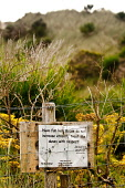 A sign warning against eroding the sand dunes by the beach at Arisaig, Highlands of Scotland. Picture Credit : Kenny Ferguson / Scottish Viewpoint   Tel: +44 (0) 131 622 7174  E-Mail : info@scottishvi... Public 2012,summer,coast,coastal,highland,erosion,nature,environment