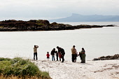 An Indian family on the beach at Arisaig, Highlands of Scotland. Picture Credit : Kenny Ferguson / Scottish Viewpoint   Tel: +44 (0) 131 622 7174  E-Mail : info@scottishviewpoint.com  This photograph... Public 2012,summer,coast,coastal,highland,people,person,sand,sandy,play,playing,children,kids