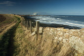 The John Muir Way near Thortonloch, with Torness Power Station visible beyond, East Lothian. Picture Credit : Keith Fergus / Scottish Viewpoint   Tel: +44 (0) 131 622 7174  E-Mail : info@scottishviewp... Public 2013,winter,sunny,atmospheric,Long,Distance,Path,footpath,Walk,Walking,Coastline,Coast,coastal,wall