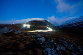 Official launch of the Outdoor Capital of the UK Mountain Festival - twenty five mountain bikers descend the red route on Nevis range in a torch led procession, Highlands of Scotland. 20.02.13 Picture... Public 2013,winter,sport,activity,highland,OCUK,dusk,evening,atmospheric,event,mountain,mountains,light,lights,trail,dramatic