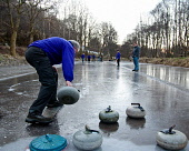 The outdoor rink of the Fort William curling club, Highlands of Scotland. Picture Credit : Kenny Ferguson / Scottish Viewpoint   Tel: +44 (0) 131 622 7174  E-Mail : info@scottishviewpoint.com  This ph... Public 2013,winter,sport,activity,highland,traditional,tradition,game,granite,stone,stones,atmospheric,ice,frozen,cold,people