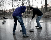 The outdoor rink of the Fort William curling club, Highlands of Scotland. Picture Credit : Kenny Ferguson / Scottish Viewpoint   Tel: +44 (0) 131 622 7174  E-Mail : info@scottishviewpoint.com  This ph... Public 2013,winter,sport,activity,highland,traditional,tradition,game,granite,stone,stones,atmospheric,ice,frozen,cold,people,brush,brushing,motion,blur,blurry
