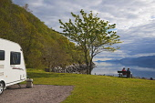 A caravans by Loch Linnhe at Onich, looking towards Ardgour, Highlands of Scotland. Picture Credit : D Barnes / Scottish Viewpoint   Tel: +44 (0) 131 622 7174  E-Mail : info@scottishviewpoint.com  Thi... Public 2012,spring,sunny,Highland,Region,peaceful,escape,travel,touring,caravanning,holiday,vacation,people,couple,seat,seated,bench,calm