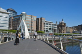 The Tradeston Bridge also known as the Squiggly Bridge over the River Clyde, Glasgow. Picture Credit : D Barnes / Scottish Viewpoint   Tel: +44 (0) 131 622 7174  E-Mail : info@scottishviewpoint.com  T... Public 2012,summer,sunny,people,walkway,walking,International,Financial,Services,District,IFSD,foot,bridge,footbridge,buildings,architecture,bike,cyclist,cycling