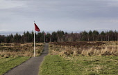 Culloden Battlefield site, near Inverness, Highlands of Scotland. The red flags indicate the Hanoverian lines on the battlefield. Picture Credit : Iain McLean / Scottish Viewpoint  Tel: +44 (0) 131 62... Public 2013,winter,sunny,attraction,visitor,tourist,tourism,history,heritage,national,trust,nts,highland