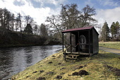 A fishing hut on the River Spey at Grantown-on-Spey, Highlands of Scotland. Picture Credit : Iain McLean / Scottish Viewpoint  Tel: +44 (0) 131 622 7174  E-Mail : info@scottishviewpoint.com  Web: www.... Public 2013,winter,sunny,activity,activities,angler,anglers,angling,fish,fishing,bothy,net,equipment,water,highland