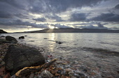 Looking over the Sound of Mull from Inninmore Bay, Morvern, Highlands of Scotland. Credit : Chris Simmons / Scottish Viewpoint  Tel: +44 (0) 131 622 7174  E-Mail : info@scottishviewpoint.com  Web: www... Public 2013,winter,atmospheric,atmosphere,hill,hills,moody,mystery,brooding,water,flow,highland,cloudy,clouds,dusk,evening,sunset,sunbeam,sunbeams,coast,coastal,coastline,foreshore,rocks,sea