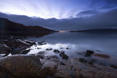 Looking over the Sound of Mull from Inninmore Bay, Morvern, Highlands of Scotland. Credit : Chris Simmons / Scottish Viewpoint  Tel: +44 (0) 131 622 7174  E-Mail : info@scottishviewpoint.com  Web: www... Public 2013,winter,atmospheric,atmosphere,hill,hills,moody,mystery,brooding,water,highland,cloudy,clouds,coast,coastal,coastline,foreshore,rocks,sea,dawn,morning,still,stillness