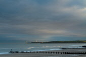 Girdle Ness and the North Sea from Aberdeen Beach at dusk, Aberdeenshire. Picture Credit: Keith Fergus / Scottish Viewpoint Tel: +44 (0) 131 622 7174   E-Mail : info@scottishviewpoint.com This photogr... Public 2011,winter,atmospheric,dramatic,light,clouds,sand,sandy,walk,walking,recreation,groyne