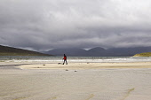 A lone figure walks on the beach at Seilebost, Harris, Outer Hebrides.Picture Credit: Janet Burdon / Scottish ViewpointTel: +44 (0) 131 622 7174  E-Mail : info@scottishviewpoint.comThis photograph can... 2011,summer,weather,western,isles,island,isle,sand,sandy,coast,coastal,clouds,water,walker,walking,stick