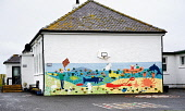 The mural painted on the end wall of Seilebost primary school, Harris, Outer Hebrides. Picture Credit: Richard Burdon / Scottish Viewpoint Tel: +44 (0) 131 622 7174   E-Mail : info@scottishviewpoint.c... 2011,summer,western,isles,island,isle,education,playground,basketball,hoop,net