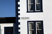 Charlotte Street, Port Ellen on the Isle of Islay, Inner Hebrides. Picture Credit : Iain McLean / Scottish Viewpoint Tel: +44 (0) 131 622 7174   E-Mail : info@scottishviewpoint.com This photograph can... Public 2011,winter,sunny,building,street,housing,sign,gaelic,island