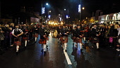 Biggar pipe band lead the torchlight procession along the High Street in Biggar before the lighting of the Hogmanay bonfire, South Lanarkshire. Picture Credit : Andrew Wilson / Scottish Viewpoint Tel:... Public 2011,winter,town,event,people,crowd,pipers,tartan,kilt,panoramic