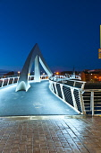 The Tradeston footbridge or Squiggly Bridge over the River Clyde at dusk, in the city centre of Glasgow. Picture Credit : D. G. Farquhar / Scottish Viewpoint Tel: +44 (0) 131 622 7174   E-Mail : info@... Public summer,atmospheric,evening,light,floodlit,reflection,engineering,structure