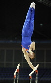 Daniel Purvis (Great Britain and Scotland) competing on the Parallel Bars at the London Prepares Series Test Event at the North Greenwich Arena, London, January 2012. Picture Credit : Eileen Langsley... Public, NMR interior,sport,man,male,mens,indoor,arena,event,competitor,competition,Dan,British,winner,apparatus,concentration,focus