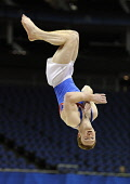 Daniel Purvis (Great Britain and Scotland) competing on Floor Exercise at the London Prepares Series Test Event at the North Greenwich Arena, London, January 2012. Picture Credit : Eileen Langsley / S... Public, NMR interior,sport,man,male,mens,indoor,arena,event,competitor,competition,Dan,British,winner,concentration,focus