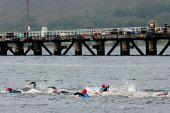 The swim section in Loch Linnhe of the Big Triathlon, Fort William, Highlands of Scotland. Picture Credit : Kenny Ferguson / Scottish Viewpoint Tel: +44 (0) 131 622 7174   E-Mail : info@scottishviewpo... Public 2008,Lochaber,athlete,athelete,swimmers,compete,competition,endurance,event,extreme,sport,activity,water,wetsuit