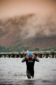 A swimmer emerges from Loch Linnhe after the swim section of the Big Triathlon, Fort William, Highlands of Scotland. Picture Credit : Kenny Ferguson / Scottish Viewpoint Tel: +44 (0) 131 622 7174   E-... Public, NMR 2008,Lochaber,athlete,athelete,swimmers,compete,competition,endurance,event,extreme,sport,activity,water,wetsuit