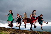 Ceilidh celebrations at the top of Anoach Mor near Fort William, Highlands of Scotland. Picture Credit : Kenny Ferguson / Scottish Viewpoint Tel: +44 (0) 131 622 7174   E-Mail : info@scottishviewpoint... Public, NMR 2011,summer,event,jump,kilt,male,man,woman,women,tartan