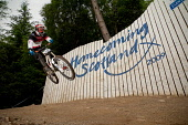 A downhill mountain biker on the wall at the UCI Mountain Bike World Cup Finals, Fort William, Highlands of Scotland.  Picture Credit : Kenny Ferguson / Scottish Viewpoint Tel: +44 (0) 131 622 7174... Public, NMR 2009,summer,event,bicycle,biking,cyclist,competitor,competition,homecoming,big,air,jump