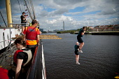 Glasgow Rat Race Riverside Adventure, 2011. Picture Credit : Kenny Ferguson / Scottish Viewpoint Tel: +44 (0) 131 622 7174   E-Mail : info@scottishviewpoint.com This photograph cannot be used without... Public, NMR summer,sunny,city,clyde,compete,competition,competitor,competitors,tall,ship,tallship,jump,enjoy,enjoyment,event,ratrace,extreme,fun,glasgow,people