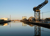 The SECC Armadillo or Clyde Auditorium and Finnieston Crane by the River Clyde, west of the city centre of Glasgow.  Picture Credit: Scott Broadley / Scottish Viewpoint  Tel: +44 (0) 131 622 7174  E-M... Public 2012,winter,sunny,reflection,calm,mirror,water,building,architecture,venue,concert,exhibition,conference,centre,crowne,plaza,hotel,accommodation,pacific,quay,bbc