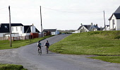Children cycling at Scarinish on the Isle of Tiree, Inner Hebrides. Picture Credit : Iain McLean / Scottish Viewpoint  Tel: +44 (0) 131 622 7174  E-Mail : info@scottishviewpoint.com  Web: www.scottish... Public 2012,spring,sunny,housing,island,argyll,activity,bike,bikes,bicycle,bicycles,village,community