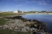 Scarinish on the Isle of Tiree, Inner Hebrides. Picture Credit : Iain McLean / Scottish Viewpoint  Tel: +44 (0) 131 622 7174  E-Mail : info@scottishviewpoint.com  Web: www.scottishviewpoint.com This p... Public 2012,spring,sunny,housing,island,argyll,village,community,hotel,accommodation,coast,coastal,water,beach,sand,sandy