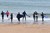 Learning to surf at Coldingham Bay, Scottish Borders. Picture Credit : Jack Byers / Scottish Viewpoint  Tel: +44 (0) 131 622 7174  E-Mail : info@scottishviewpoint.com  Web: www.scottishviewpoint.com T... Public, NMR 2011,summer,activity,surfing,surfers,wetsuit,wetsuits,beach,sand,sandy