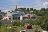 The Scottish Parliament Building at Holyrood, with a view beyond to Calton Hill, Edinburgh.  Picture Credit : D Barnes / Scottish Viewpoint  Tel: +44 (0) 131 622 7174  E-Mail : info@scottishviewpoint.... Public 2010,summer,sunny,architecture,design,attraction,visitor,politics,tour,bus,sightseeing,people,city