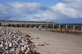 Lossiemouth, Moray. Picture Credit : D Barnes / Scottish Viewpoint  Tel: +44 (0) 131 622 7174  E-Mail : info@scottishviewpoint.com  Web: www.scottishviewpoint.com This photograph cannot be used withou... Public 2012,winter,sunny,coast,coastal,water,beach,sand,sandy,lighthouse,people,family,child,children,dog,pet,walking
